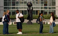 Students near Citizen Scholar statue